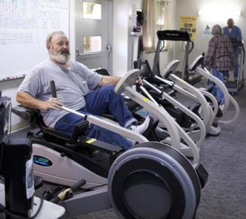 man on a seated pedal pushing machine